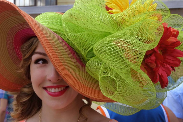Audra Harris of Weathersfield, Conn. shows off her hat during the 2014 Preakness Saturday., May 17, 2014. (Karl Merton Ferron/Baltimore Sun Staff)