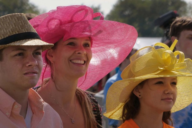 Jaxon Clark, 16 and Macie Clark, 12 flank their mother Leslie Clark of Springfield VA who enjoys live music during the 2014 Preakness Saturday., May 17, 2014. (Karl Merton Ferron/Baltimore Sun Staff)