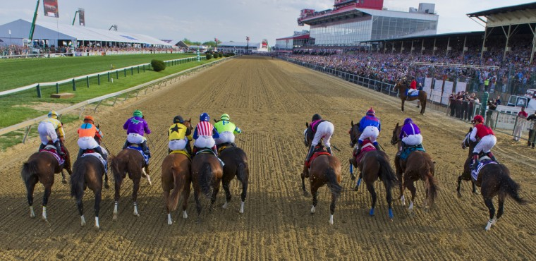 California Chrome (third from left) and the field head out of the starting gate in the running of the 139th Preakness on Saturday. Chrome beat the field to win, with a chance for a Triple Crown. (Karl Merton Ferron/Baltimore Sun)
