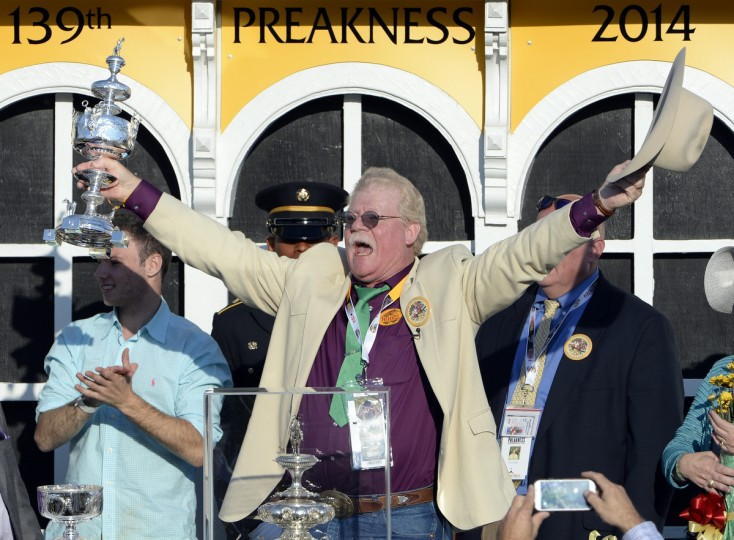 At the Winner's Circle, California Chrome's co-owner Steve Coburn, celebrates after winning the 139th running of the Preakness Race. (Kenneth K. Lam/Baltimore Sun)