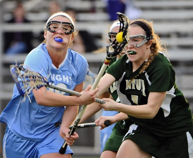 C. Milton Wright's Lauren Cavanaugh, left, is fouled by Century's Kylie Davis in the second half. C. Milton Wright defeated Century, 14-13. (Kenneth K. Lam/Baltimore Sun)