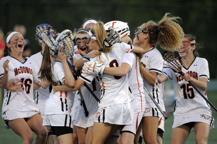No. 1-ranked McDonogh celebrates after winning against No. 6-ranked Roland Park in the IAAM A Conference girls lacrosse tournament held at Stevenson University. (Algerina Perna/Baltimore Sun)