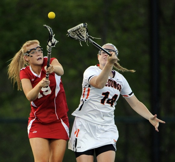 Roland Park's Cece Finney, left, and McDonogh's Olivia Jenner, vie for the ball in a face-off in the first half. No. 1-ranked McDonogh won against No. 6-ranked Roland Park. (Algerina Perna/Baltimore Sun)