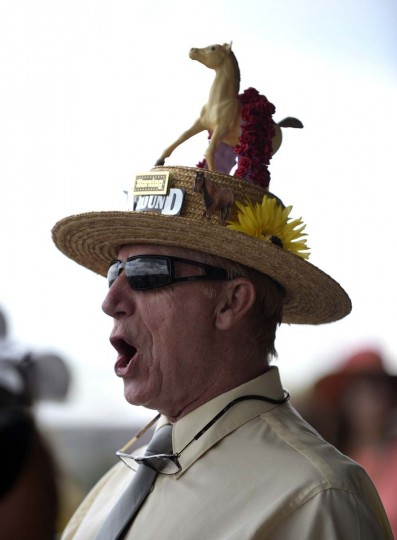 Mike Seiter of Rockville watches the races at 139th Preakness Stakes at Pimlico Race Course. (Lloyd Fox/Baltimore Sun)