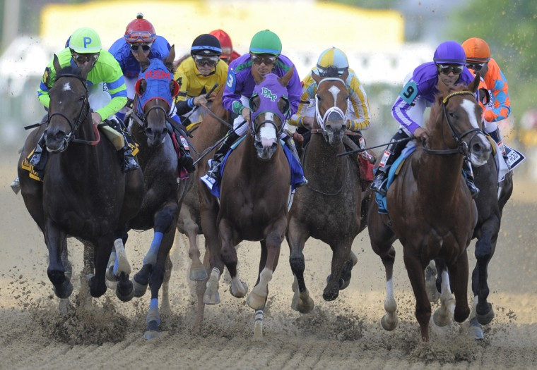 California Chrome (middle) heads into the first turn. (Lloyd Fox/Baltimore Sun)