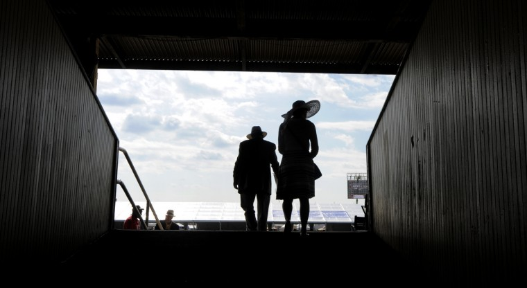 Keith Winkeler, left, and his daughter, Lucia, came to Preakness from Austin, Texas. (Lloyd Fox/Baltimore Sun)