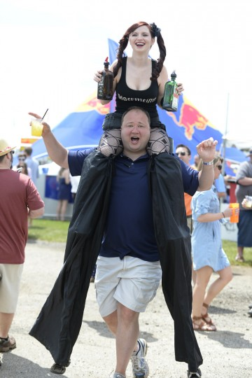 Ron Tanney of Mt. Carmel, Pa., carries Amber Phelps on his shoulders in the infield. (Lloyd Fox/Baltimore Sun)