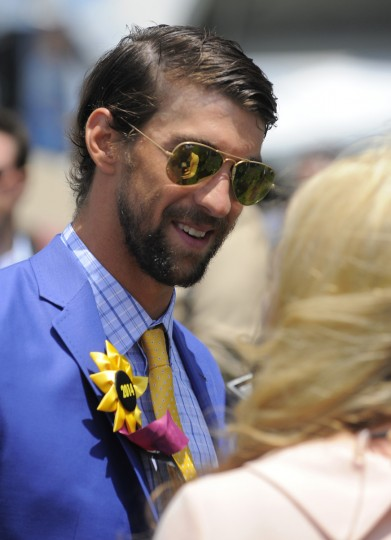 Michael Phelps does an interview with NBC TV outside the Under Armour/Sagamore Farms tent located in the infield at Pimlico. (Robert K. Hamilton/Baltimore Sun)