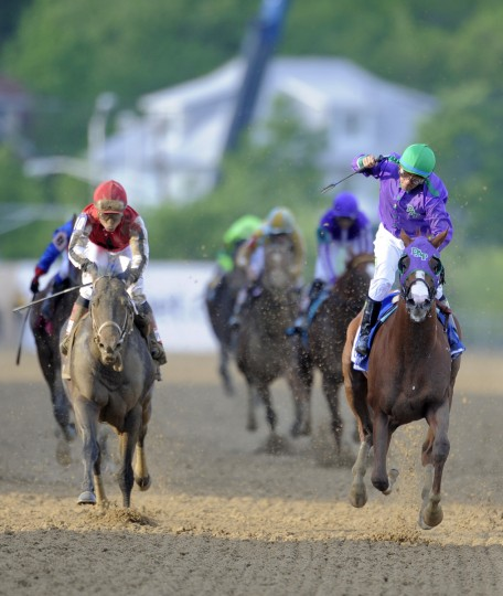 California Chrome cross the finish line to win the 139th running of the Preakness Race, the second jewel in the Triple Crown. (Lloyd Fox/Baltimore Sun)