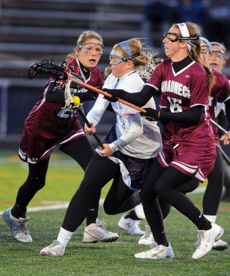 South River's Madison Carter, center, tries to get around Broadneck's Natalie Hendricks, left, and Ellie McNulty, right, in the first half. (Kenneth K. Lam/Baltimore Sun)