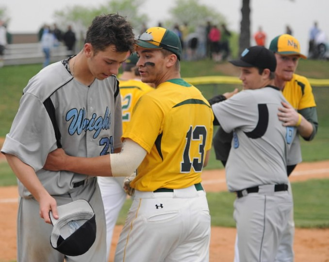 North Harford's Scott Angstadt, center, congratulates C. Milton Wright catcher Colin Miller on a good game after Monday's baseball game at North Harford. (Matt Button, Baltimore Sun Media Group)