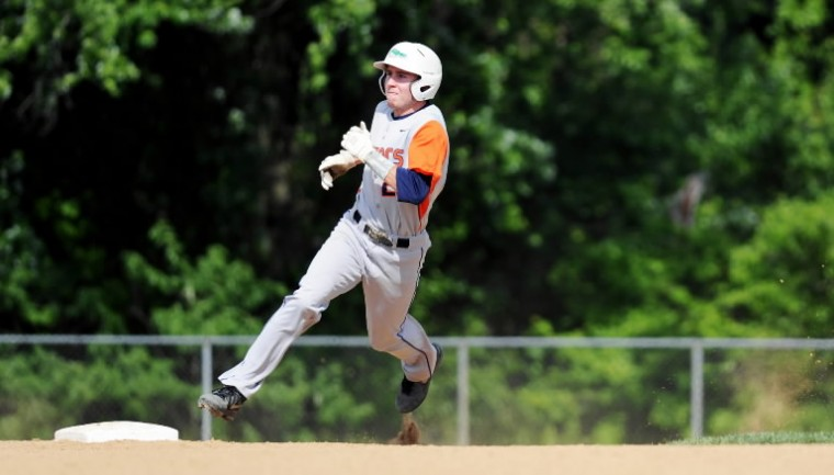 Reservoir's Joe Kearney looks for the ball in left field as he rounds second base, deciding whether to push on to third during the Class 3A state semifinal baseball game against Governor Thomas Johnson at Joe Cannon Stadium in Hanover on Tuesday, May 20, 2014. (Jon Sham/BSMG)