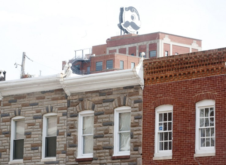 The Natty Boh Tower, a mixed use building that formerly served as a brewery, can be seen from most of the resident neighborhood of Brewer's Hill. (Baltimore Sun Media Group photo by Sarah Pastrana)