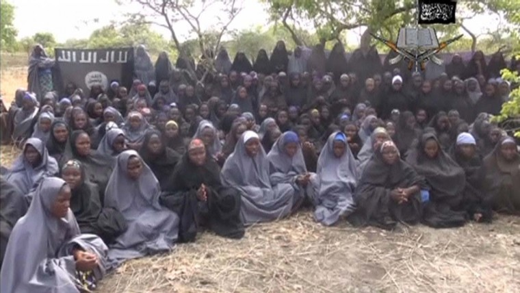 Kidnapped schoolgirls are seen at an unknown location in this still image taken from an undated video released by Nigerian Islamist rebel group Boko Haram. The leader of the Nigerian Islamist rebel group Boko Haram has offered to release more than 200 schoolgirls abducted by his fighters last month in exchange for prisoners, according to a video seen on YouTube. About 100 girls wearing full veils and praying are shown in an undisclosed location in the 17-minute video in which Boko Haram leader Abubakar Shekau speaks. (Boko Haram handout via Reuters TV/Reuters)