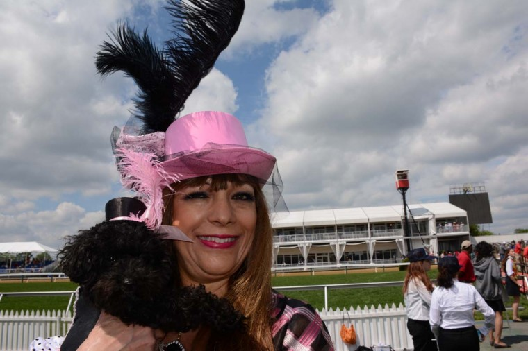 """Carol Huff, 58, Philadelphia, commercial real estate tenant representative, and her 15-month-old toy poodle, Tiffany wore the same outfits to Preakness. """"We had a Kentucky Derby party, and we matched my hat to hers,"""" she said. (Sloane Brown/For the Baltimore Sun)"""
