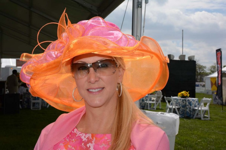 "Lisa Kozemchak, 45, Bloomfield Hills, Mich. community volunteer. ""I've had this hat for 2 years, and finally decided this was the year. You can't rewear a hat to Preakness. That's a faux pas."" (Sloane Brown/For the Baltimore Sun)"