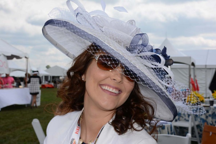 """Shannon Scriba, 27, Millersville, JBA Chevrolet finance manager. """"This hat was all white. So I went to Michael's and loaded up on blue. [Then] I added al the blue [ribbon] and flowers."""" (Sloane Brown/For the Baltimore Sun)"""