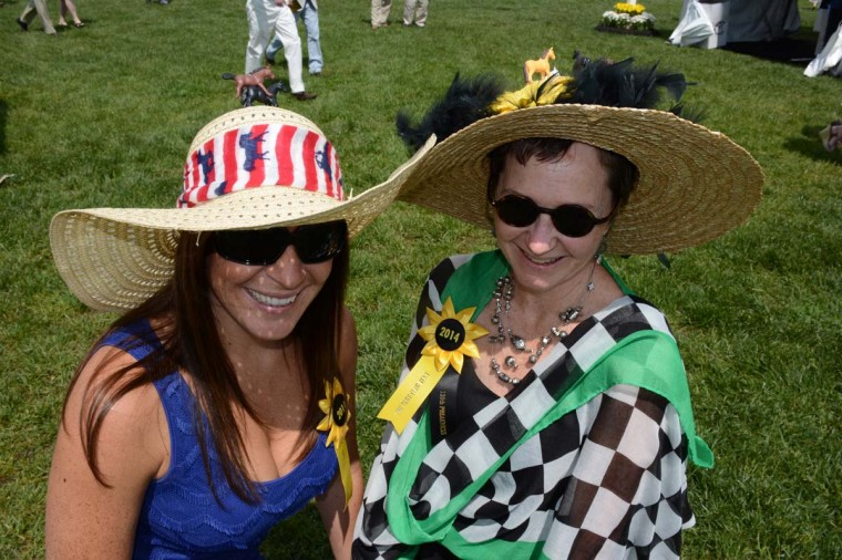 """Pam Clark, 55, Raleigh, N.C. culinary instructor, originally from Severna Park. She and Carina Barton made their hats the day before, after arriving in Baltimore. """"I brought my glue gun,"""" said Clark. """"We made them 'over wine,'"""" added Barton, with a laugh. (Sloane Brown/For the Baltimore Sun)"""
