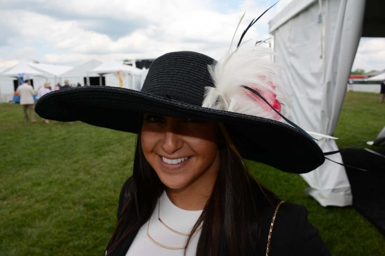 """Melissa Cifone, 23, Baltimore, Transamerica account executive. """"I was doing the whole black and white thing and I wanted something to pop. So, I picked the hat with the red rose,"""" she said. (Sloane Brown/For the Baltimore Sun)"""