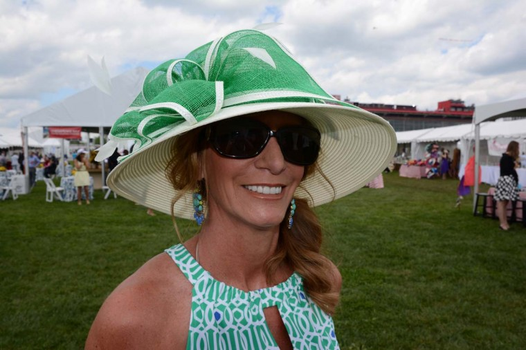 "Kristen Butler, 44, Bel Air-based interior designer. ""Usually I [pick] the hat first. But, this year I wanted something to match my green and white dress. The hat came second,"" she said. (Sloane Brown/For the Baltimore Sun)"