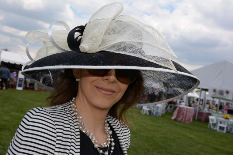 "Liliana Kelley, 38, Lutherville architectural designer. Black and white is a favorite color theme. ""I decided last minute to come to Preakness. I found this yesterday at Macy's,"" she said. (Sloane Brown/For the Baltimore Sun)"