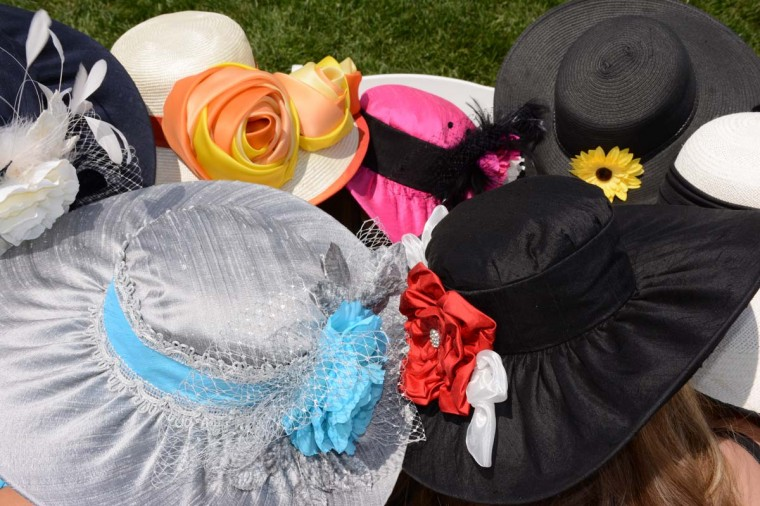 "This group of 7 women come together every year to Preakness. Everyone has to wear a hat, many of them lent by Beth Boots-Workman, who wore it to a previous Preakness. ""We make it the ultimate girls' day – the one day the husbands aren't allowed to ask questions about,"" said Boots-Workman. (Sloane Brown/For the Baltimore Sun)"