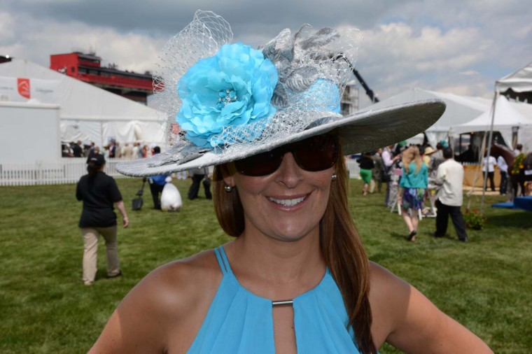 Cassidy Capfhammer, 38, New Freedom, Penn. resident, Baltimore City police detective. She always gets her Preakness hats from ladydianehats.com. and has the designer make a hat to match a chosen outfit. (Sloane Brown/For the Baltimore Sun)