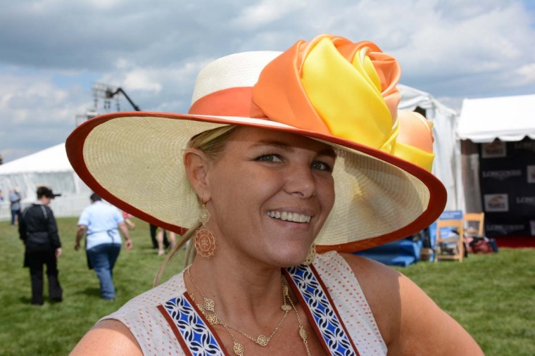 "Beth Boots-Workman, 36, Catonsville, Entertainment Consultants International general manager. She gets a new hat every year. ""I got this at Hats in the Belfry last minute. I was looking for orange this year,"" she said. (Sloane Brown/For the Baltimore Sun)"