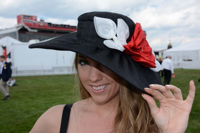 "Elizabeth Williams, 26, Power Plant Live! manager. ""I have never been to Preakness before. I love bows and I like the really big brim,"" she said, explaining her Hats in the Belfry acquisition. (Sloane Brown/For the Baltimore Sun)"