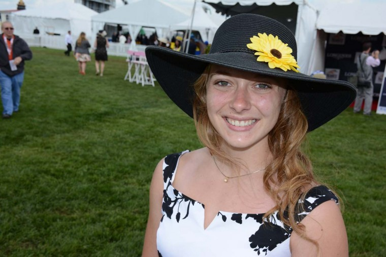 """Alyssa Keefer, 20, Manheim, Penn. nursing school student. """"I borrowed this from Channing James. She wore it to Preakness a couple of years aog. I went well with my dress and [doing] Preakness colors was my goal,"""" she said. (Sloane Brown/For the Baltimore Sun)"""