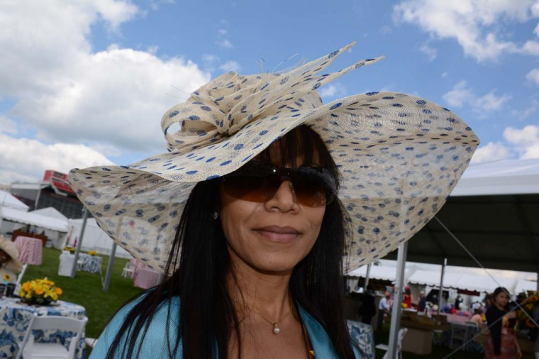 "Maryann Parrilla, 40, Sicklerville, N.J., retired CPA. ""I didn't know what I was going to wear [to Preakness]. This was neutral and would go with just about anything,"" she said. (Sloane Brown/For the Baltimore Sun)"