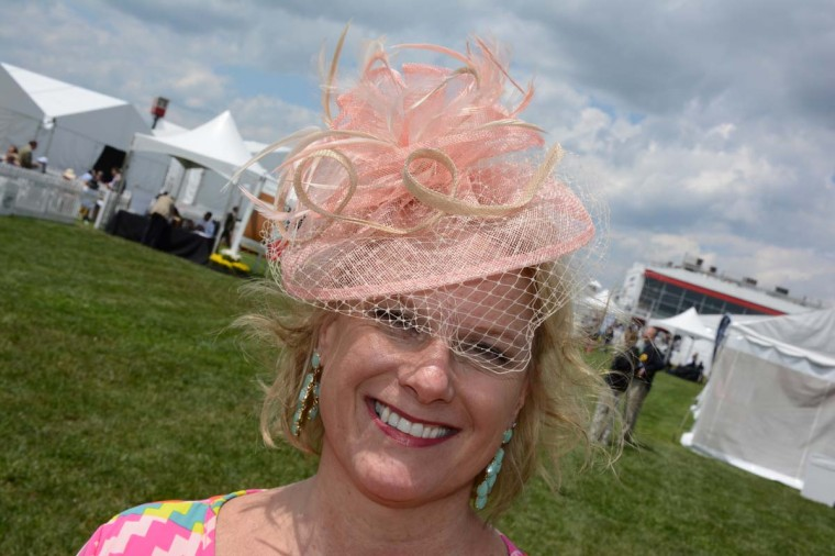 """Pam Healy, 50, Owings Mills, business consultant. """"I ordered four [hats] online and picked this one. It's easy,"""" she said. (Sloane Brown/For the Baltimore Sun)"""