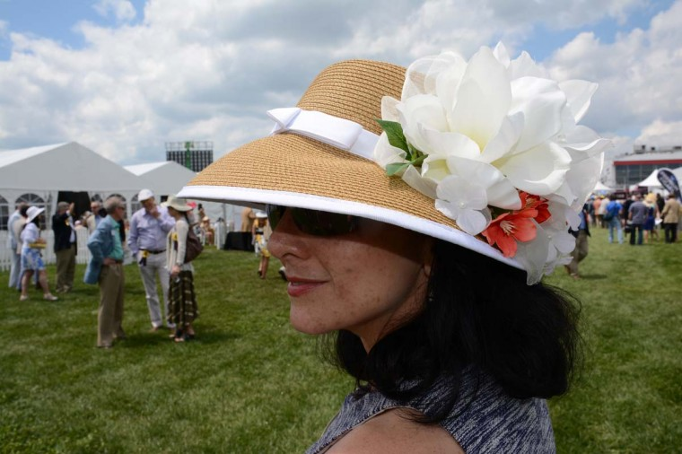 "Gina Navarro, 47, Sparks, University of Maryland sustainable floods coordinator. ""It's a sun hat [where] I added the flowers. I was going to keep my hat simple, and then I thought why?"" she said. (Sloane Brown/For the Baltimore Sun)"