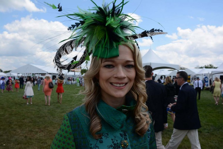 """Lacey Johansson, 34, Federal Hill, St. Johns Properties leasing agent. She got her fascinator at Fleur de Paris on a trip to New Orleans, where they created it just for her. """"I said I needed something to go with green, black and white,"""" she said. (Sloane Brown/For the Baltimore Sun)"""