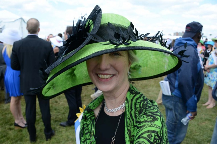 """Ellen Yankelow, """"over 60,"""" Lutherville, Correct Rx Pharmacy president/CEO. """"My assistant helped Marjae Hats with the design, to go with a green dress. When I got the hat, it didn't match the dress. But, I loved it. So, I got a black dress and green and black scarf to match it,"""" she said. (Sloane Brown/For the Baltimore Sun)"""