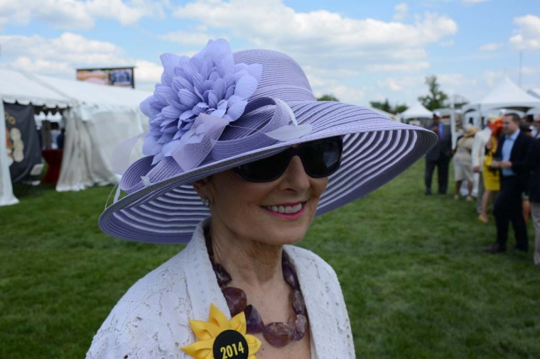 "Lainy LeBow-Sachs, 69, Stevenson, Kennedy Krieger Institute executive vice president. ""I got it from Hats in the Belfry. I loved it because purple is my favorite color,"" she said. (Sloane Brown/For the Baltimore Sun)"