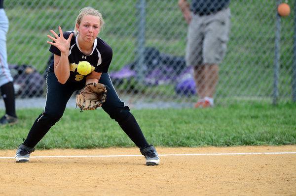 Mt. Hebron's Stephanie Bluhm fields the ball during the softball regional championship game against Glenelg Thursday, May 15. (Matt Hazlett, Baltimore Sun Media Group)
