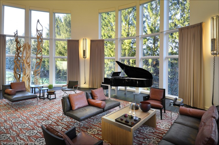 As you walk into the front door of the house and step through the foyer, one of the first room you see is the formal living area with a grand piano. (JS Eckert Photography)