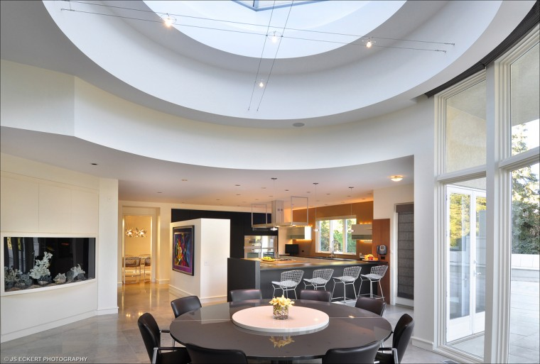 The kitchen eating area has a large skylight that bathes the room in light during the day. (JS Eckert Photography)