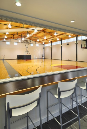 The home even has a full sized regulation basketball court located inside. (JS Eckert Photography)