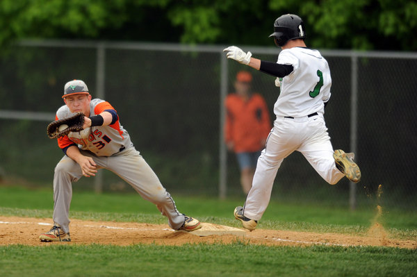 Reservoir's Jon Mierzwa squeezes the ball in his glove, beating Atholton's Dan McCann to first base for a force out during the 3A East regional playoff baseball game at Atholton High School on Wednesday, May 14. (Brian Krista, Baltimore Sun Media Group)