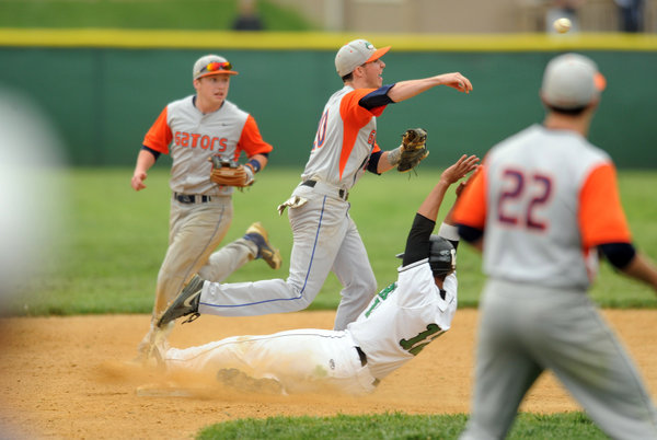 Reservoir shortstop Joe Kearney steps on second to force out Atholton's Brady Acker and throws to first to complete the double play and end the sixth inning during the 3A East playoff baseball game at Atholton High School on Wednesday, May 14. (Brian Krista, Baltimore Sun Media Group)
