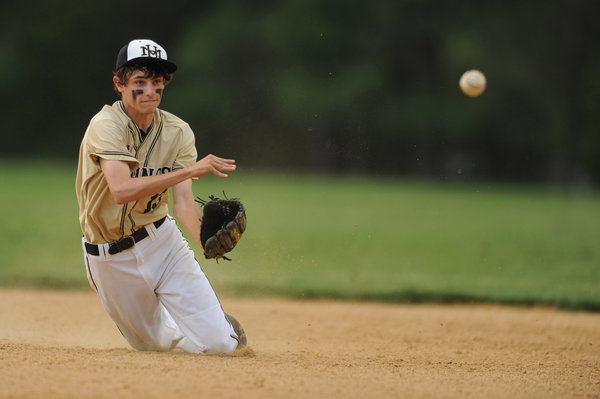 Mt. Hebron second baseman Joey Trapuzzano throws from his knees in an attempt to force out a Centennial batter during playoff baseball game at Mt. Hebron High School on Monday, May 12. (Brian Krista, Baltimore Sun Media Group)