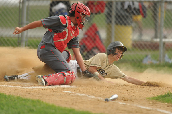 Mt. Hebron's Kevin Broache slides safely into home, beating a throw to Centennial catcher Nick Varner during playoff baseball game at Mt. Hebron High School on Monday, May 12. (Brian Krista, Baltimore Sun Media Group)