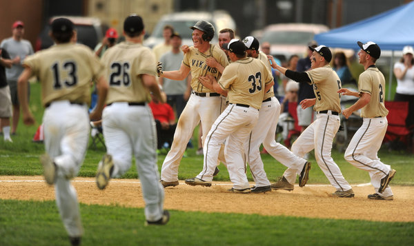 The Mt. Hebron baseball team surrounds senior catcher Paul Lutchenkof after his clutch, game-winning RBI single against rival Centennial in the 3A East regional quarterfinals May 12. (Brian Krista, Baltimore Sun Media Group)