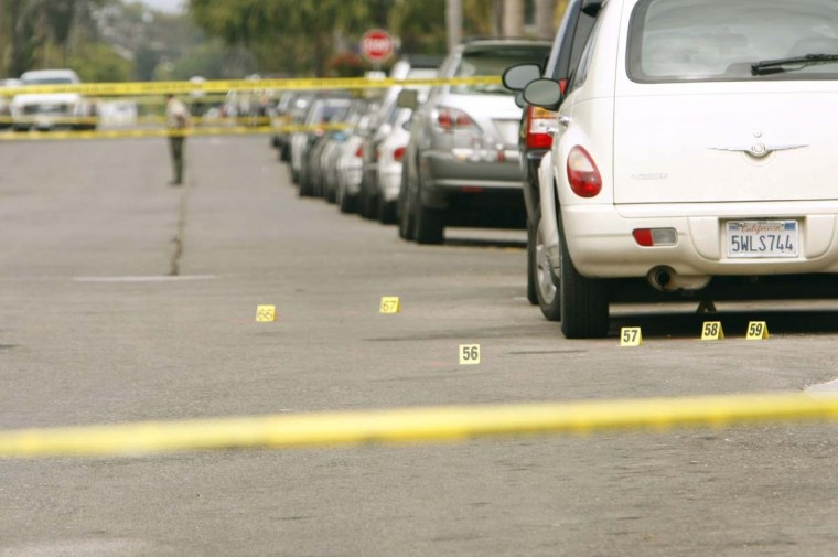 Police investigation markers show where a victim was shot on Trigo Road in Isla Vista, Calif., Friday night, May 23, 2014.The shooting was part of a rampage that killed seven near the University of California Santa Barbara. (Al Seib/Los Angeles Times)