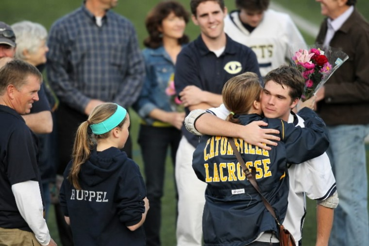 Catonsville senior Stephen Ruppel, right, hugs his family before the boys lacrosse game against Towson at Catonsville High School. (Jen Rynda/BSMG)