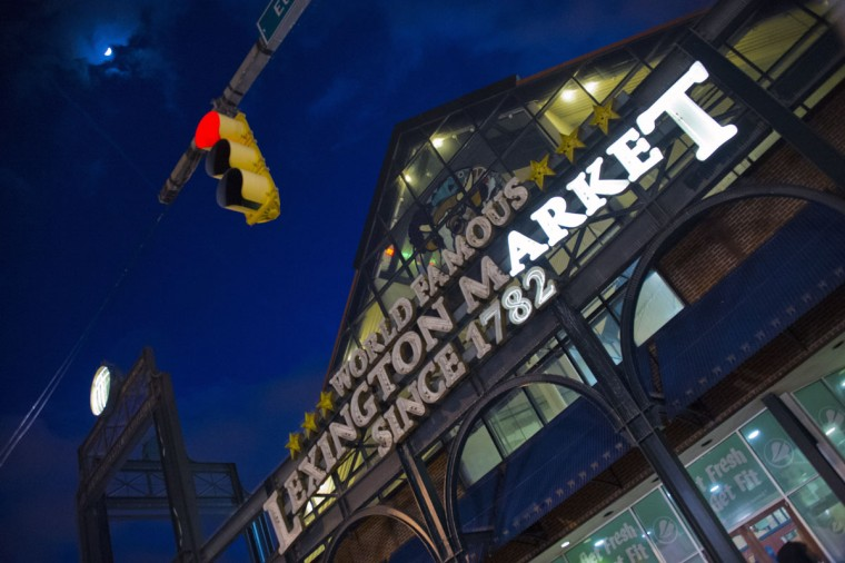 The neon sign atop Lexington Market not entirely lit as dusk settles over the historic market in a view of the Eutaw Street entrance in 2014. (Sun photo by Karl Merton)