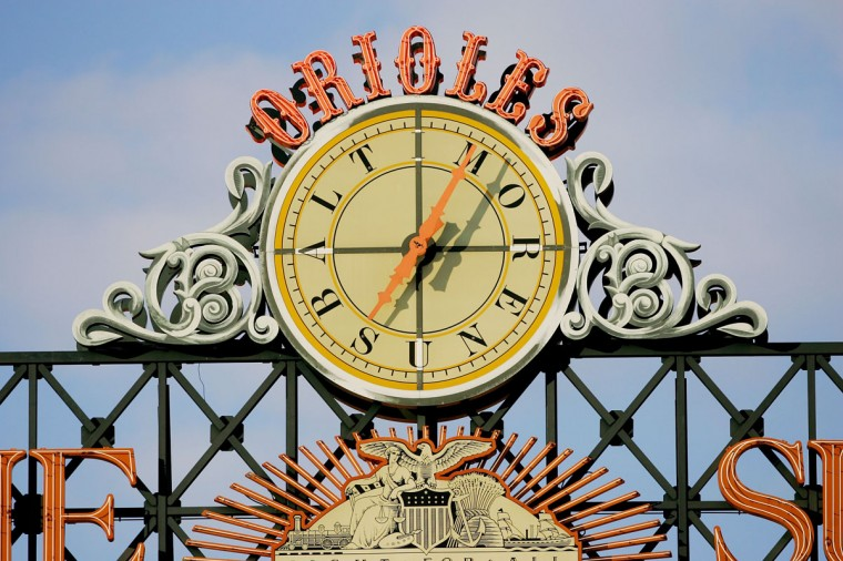 The outfield clock above the scoreboard is shown during the Baltimore Orioles game against the Toronto Blue Jays at Oriole Park at Camden Yards in 2006. (Photo by Jamie Squire/Getty Images)