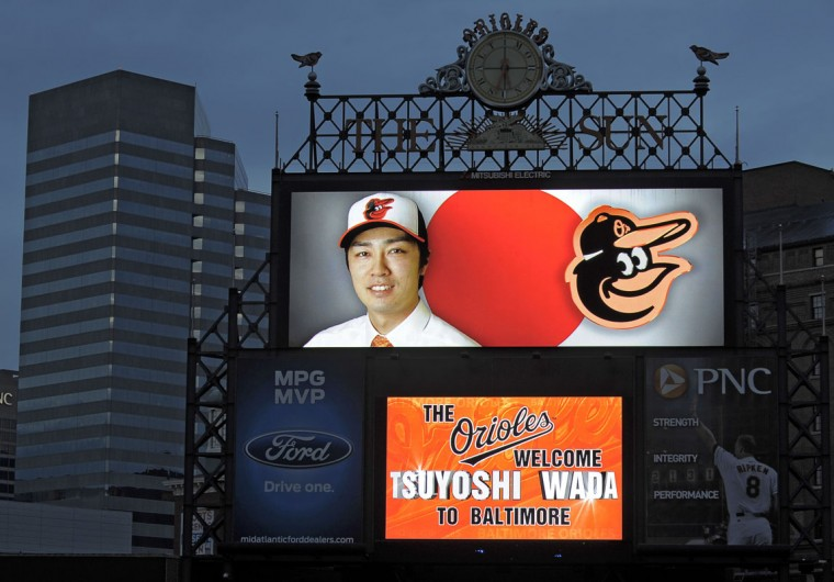 The scoreboard glows on a dreary fall evening, sending a welcome message to left-handed pitcher Tsuyoshi Wada in 2011, to announce the signing of the Olympics bronze medalist from Japan, to a two-year contract. (Sun photo by Karl Merton Ferron)